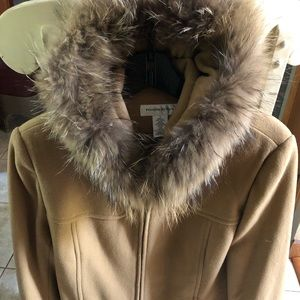 Ladies wool coat with raccoon fur.
